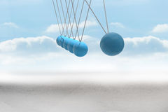 Newtons cradle above desert Royalty Free Stock Photos