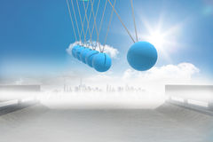 Newtons cradle above road to city Royalty Free Stock Images