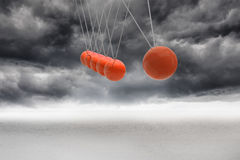 Newtons cradle above stormy desert Stock Photo