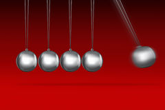 Newtons cradle idea on red Stock Image