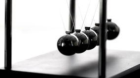 Newtons cradle in motion on white background Royalty Free Stock Photography