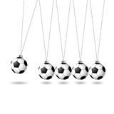 Newtons cradle with soccer balls Stock Photography