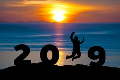 Newyear 2019 concept Silhouette young businessman is jumping to 2019 new year. Newyear 2019 concept Silhouette young businessman jumping to 2019 new year royalty free stock photos