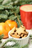 NewYear. Cup of coffee. Delicious tangerines. Spruce branch. Blurred background stock image