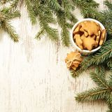 NewYear. Delicious ginger biscuits. Fir branch. Light background.  royalty free stock photography