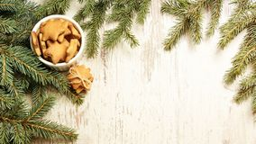 NewYear. Delicious ginger biscuits. Fir branch. Light background.  royalty free stock photo