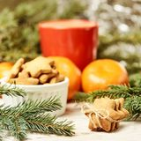 NewYear. Gingerbread Cookie. Orange tangerines. Spruce branch royalty free stock images