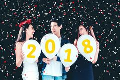 Newyear party ,celebration party group of asian young people holding balloon numbers 2018 happy and funny concept.  stock photos