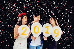 Newyear party ,celebration party group of asian young people holding balloon numbers 2019 happy and funny concept.  stock photography