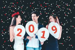 Newyear party ,celebration party group of asian young people holding balloon numbers 2019 happy and funny concept.  royalty free stock photography