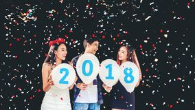 Newyear party ,celebration party group of asian young people holding balloon numbers 2018 happy and funny concept.  royalty free stock image