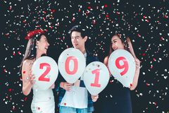 Newyear party ,celebration party group of asian young people holding balloon numbers 2019 happy and funny concept.  royalty free stock photo