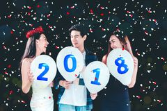 Newyear party ,celebration party group of asian young people holding balloon numbers 2018 happy and funny concept.  stock images