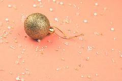 NewYear`s gold ball with beads scattered around. royalty free stock photos