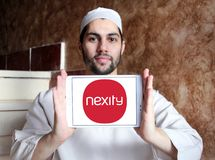 Nexity real estate development company logo. Logo of Nexity company on samsung tablet holded by arab muslim man. Nexity is a French company that focuses on real royalty free stock photography
