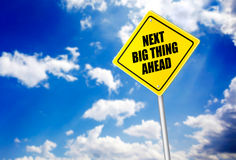 Next big thing ahead message on road sign Stock Images