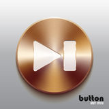 Next bronze button with white symbol. Next round button with white symbol and brushed bronze texture isolated on gray background Stock Photo