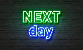 Next day neon sign on brick wall background. Royalty Free Stock Image