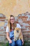 Next door girl and her pet Stock Photo