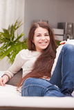 Next door girl smiling in her living room Stock Image