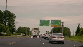 Next exit Spartanburg. Spartanburg highway exit sign, USA stock footage