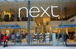 Next Fashion and Home Furniture Store in Bracknell, England. Bracknell, England - February 10, 2018: People entering the Next retail store in Bracknell, England Royalty Free Stock Images