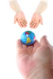 Next Generation. An adult hand handing over the world to the next generation Royalty Free Stock Image