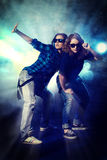 Next generation. Modern hip-hop dancers over grunge background. Urban, disco style Royalty Free Stock Image