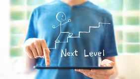 Next level concept with man using a tablet royalty free stock photography