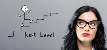 Next level concept with young businesswoman royalty free stock photography