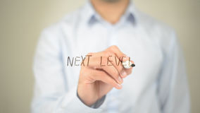 Next Level , Man writing on transparent screen Royalty Free Stock Images