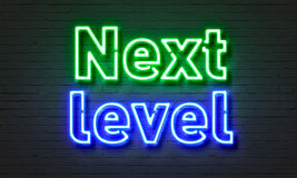 Next Level Neon Sign On Brick Wall Background. Royalty Free Stock Photo