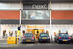 Next. LONDON - JANUARY 23rd: The exterior of Next on January the 23rd, 2015, in London, England, UK. Next is a popular retailer of high street clothing Royalty Free Stock Photos
