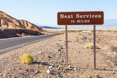 Next service. Death Valley, USA. Next service streetsight useful for travel concept Royalty Free Stock Photo