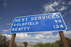 Next Services Sign in the Middle of Nevada. Next Services Sign in the Nevada's mojave desert Royalty Free Stock Photos