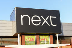 Next shop sign with logo Royalty Free Stock Photo