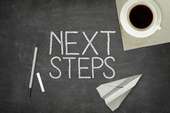 Next step concept on black blackboard Royalty Free Stock Photography