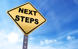 Next steps sign. On blue sky background,3d rendered Royalty Free Stock Image