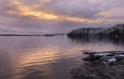 Next to lake at first snow time. Beautiful sunset at Finland when first snow rained Stock Photo