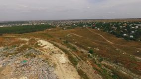 Next to the landfill, residential buildings begin. Next to the city dump, residential buildings begin stock video footage