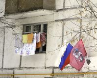 Moscow, Russia. Outside the window of a house on the street dries washed linen, clothing. Royalty Free Stock Images