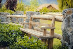 Wooden bench in green royalty free stock photos