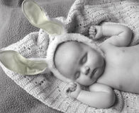 Next Year I'll Hunt (yellow). Young baby sleeping with yellow bunny ears Stock Photography