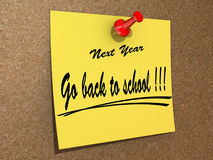 Next Year Resolution Go back to school. A note pinned to a cork board with the text Go back to school Royalty Free Stock Photography