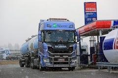 NextGen Scania Tank Truck Unloads AdBlue in Snowfall Stock Image