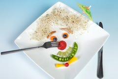 Nez de fraise sur le visage de nourriture Photographie stock