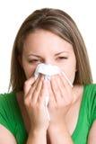 Nez de soufflement de femme photos stock