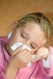 Nez de soufflement de fille Image libre de droits