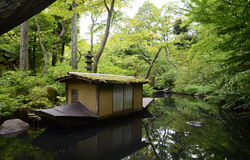 Nezu museum garden in summer, Tokyo, Japan. The original garden, designed in the shinzan-yūkoku、deep mountains and mysterious valleys, style, included rustic Stock Photo