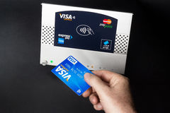 Nfc - contactless payment. Nfc - near field communication - contactless payment with Visa Credit card Royalty Free Stock Photos